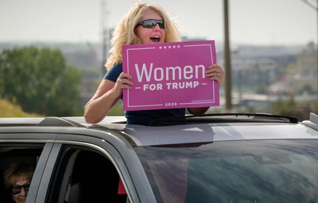 Women held up signs supporting Trump in Des Moines.