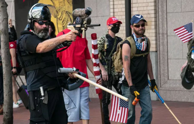 Proud Boys face off with BLM protesters in Portland on August 15. Credit: Getty Images