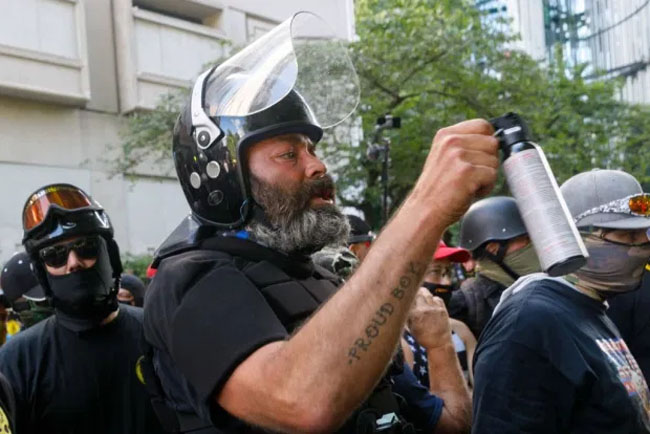 Alan Swinney holds up a pepper spray during a protest in Portland on August 22. Credit: Getty Images