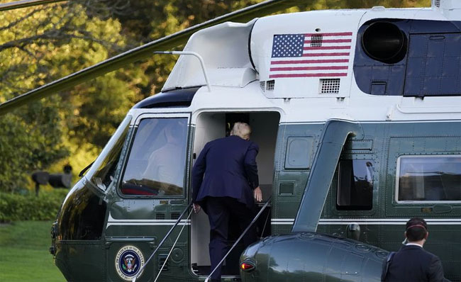 President Trump boards Marine One as he leaves the White House to go to Walter Reed National Military Medical Center after he tested positive for COVID-19. Credit: Alex Brandon/AP