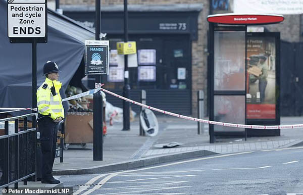 A woman in her 30s who was described by police as an 'innocent bystander' was shot in the neck