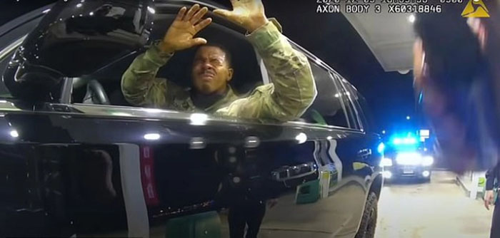 Caron Nazario can clearly be seen in bodycam footage in his uniform with his hands up
