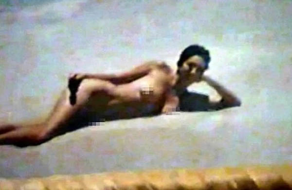 A woman alleged to be Maxwell stretches out in the sand at Jeffrey Epstein's Florida mansion. PALM BEACH STATES ATTORNEY